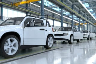 White cars in the factory