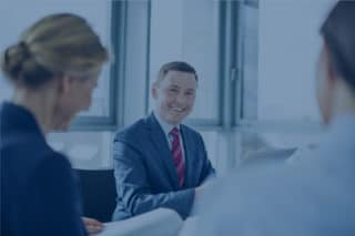 Businesspeople meeting in the conference room with blue filter